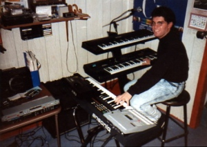 """Me at my keyboard rig around 1990. """"Time Takes Over"""" features sounds from the Roland U-20 synth on the top tier of my Apex stand (over the Ensoniq ESQ-1 on which I have my right hand)."""