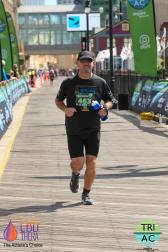 Running on the boardwalk. Photo courtesy DelMo Sports.